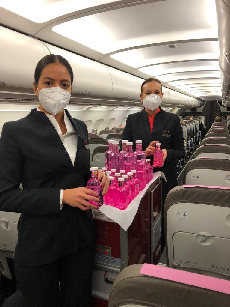 Iberia crew will give each passenger an iconic pink Solán de Cabras water bottle.